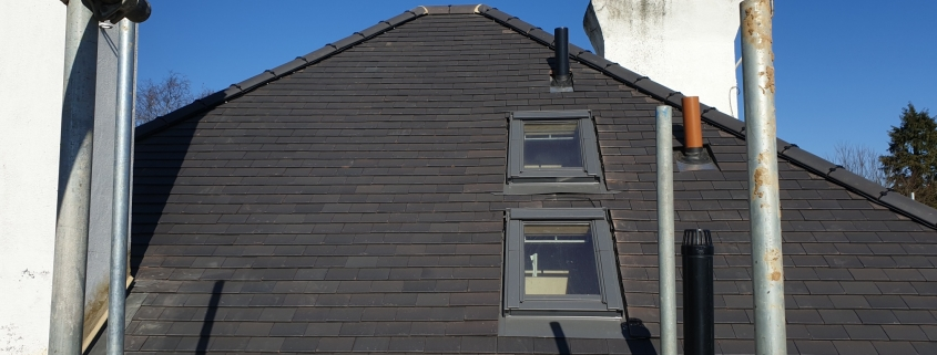Scaffold Around the Tiled Roof with Velux Windows